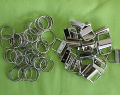 These nickel tips and rings are what everyone wants!!! This is the hardware you need to make your own key fobs/key chains, a 2-piece set. 1.25 mouth with teeth to clamp your webbing or ribbon. Buyer receives 50 29mm split rings and 50 clamps. PLEASE NOTE**** I do not separate the clamps from the rings in orders of 100 sets or less to save you money on shipping costs.  Finished key fob in picture is not for sale - just a sample of what you can do with this hardware. Have fun!!!  Please email…