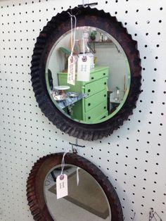 Add mirror to old pie tins. Arrange a bunch.