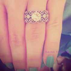 This is the perfect mix of the ring styles I like. Too bad its already taken! :/  Lucky girl! <3