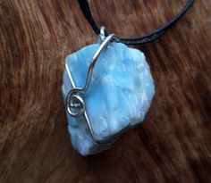 Natural larimar and sterling silver necklace Natural by Unics, $51.00