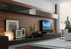 I like the modern shelves but also like the pictures and the soft unusual light for the mancave.