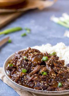 Slow Cooker Korean Beef and rice in a gray dish Slow Cooker Korean Beef is an easy crock pot dinner recipe that makes tender, sweet and spicy slow cooker beef. Korean Beef Recipes, Slow Cooker Korean Beef, Crock Pot Slow Cooker, Slow Cooker Recipes, Crockpot Recipes, Asian Recipes, Beef Dishes, Food Dishes, Roast Recipes