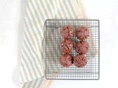 These double chocolate muffins are perfect treat and so easy to make. Filled with fruit and topped with chocolate chunks.