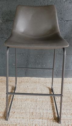 This Bar Stool is ideal for those late night chats around the kitchen island. Beautiful and simple in design with its faux leather grey bar stool.