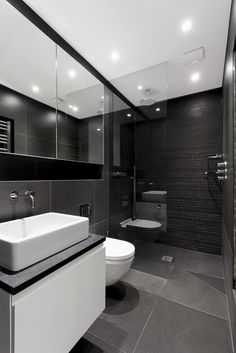 Be Bold, slate effect Shanghai Black tile 60x60cm, with complimentary strip mosaic in same material adding texture and interest to the shower wall
