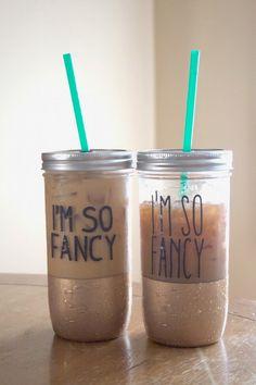 "Giltter, iced coffee, and Mason Jars…OH MY! DIY ""Fancy"" Mason Jar tumblers for a fraction of the cost of buying one! #masonjars #imsofancy #fancymasontumblers #masonjartumblers"
