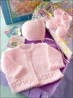 Spun Sugar Baby Set - Lacy borders adorn this sweet bonnet, sweater and booties set. Made with light (DK) weight yarn and sizes and needles. Baby Cardigan Knitting Pattern Free, Baby Knitting Patterns, Knitting Designs, Baby Patterns, Vintage Patterns, Pdf Patterns, Free Pattern, Knit Baby Sweaters, Knitted Baby Clothes
