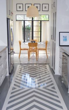 grey and white chevron painted floor;  I want to see if this can be done with vinyl tiles!