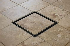 This attractive tile-in drain is an affordable alternative to linear shower drains.