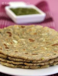 Jowar flour replaces wheat flour in this garlic infused traditional north indian breakfast delicacy. Make a filling mini meal by accompanying the parathas with fresh curds.