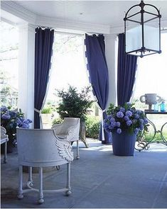 Love this! Fabulous chairs and curtains in blue, trimmed in a stripe, pretty!