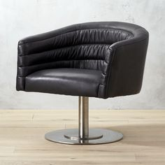 """Shop cupa black leather swivel chair.   Designed by Jannis Ellenberger, Cupa (which means barrel in Latin) adds attitude to any space.  """"Brushed steel base gives a mid century feel, but the horizontal tufts feel modern and clean,"""" explains Ellenberger."""
