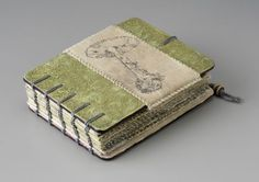 Where Spirits Blend by Sharon McCartney. Mixed media coptic bound book w/printed and embroidered organdy pages.