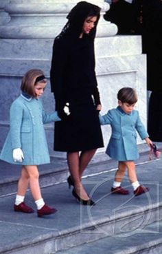 """Jackie Kennedy with her two children, Caroline and John, depart the Capitol Building where President John F. Kennedy is lying in state - November"