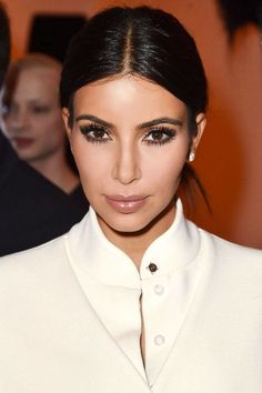 10 center part hairstyle ideas to steal from celebrities: Kim Kardashian's low ponytail