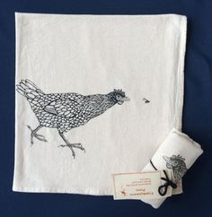 Chicken chasing fly tea towel hand printed by crankosauruspress