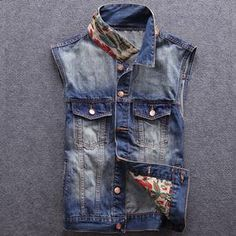 This awesome denim jean vest features front pocket closure, adjustable buttons at the waist and a beautiful, uniquely designed Indian and cross pattern on the back, and gorgeous print on the underside of the collar and jacket lining.