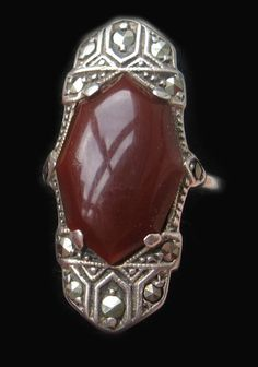 Art Deco Sterling Silver dress ring set with a large carnelian surrounded by marcasites. Marked 925  UK size 'P'. Ref  R-03 £39