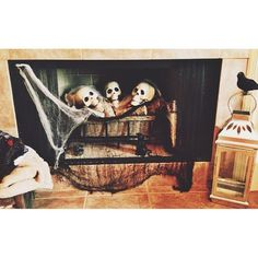 Turn your fireplace into a scary sight by throwing in some skulls and a stretched white spiderweb.