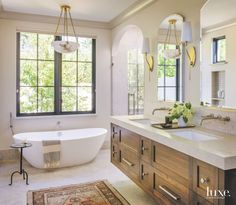 Master Bathroom with Marbled Light Sconces and Floating Vanity