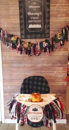 Highchair and smash cake set-up at a lumberjack-themed first birthday party!