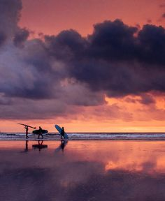 Surfer walking on the beach during a pretty sunset in Tamarindo Costa Rica. sunsets, beach sunset, sunset ocean, sunset photography, sunset pictures, sunset sky, sunset beautiful, sunset surfing, Cielo atardecer, sunset sea, sunset surf, sunset beach surf