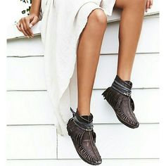 Women's Free People moccasins. Women's Free People moccasins.  Size 7. New in box. Never worn.  Chocolate brown. Soft leather moccasins featuring a rounded toe and fringe detailing. Wrap leather strap with metal accents. Treaded sole. Free People Shoes Moccasins