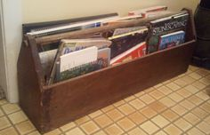 My husband's father's toolbox gets a new life as a map & book holder.