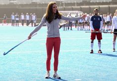 Playing field hockey with England's Olympic team.