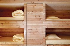 wooden-cabin-house-interior-bedding-hidden-closet