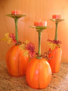 Wine Glasses painted like pumpkins and used as Candle Holders