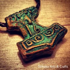 Thor's hammer with a timeworn and ancient design. Made of bronze with a green patina. #NorseMythology #ásatrú #Heathen #pagan #mjolnir #titibaka