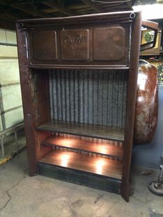 1940 ford box made into a entertainment center with hidden storage behind a flip down tailgate. Also has lighting under all shelves. Made by relics awry.