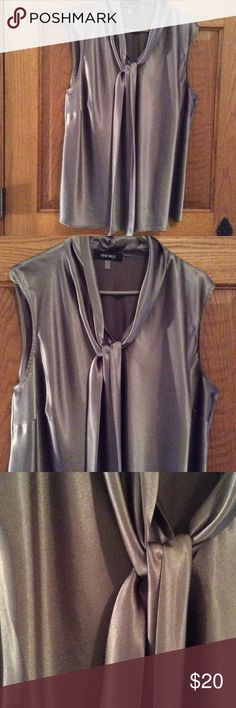 Grey satin like dress blouse Grey sleeveless. Fabric is satin like. Tie at v neck. Excellent condition Nine West Tops Blouses