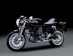 Ducati Sportclassic 1000. The same bike he zoomed around in during the introductory scenes of Tron. Damn do I want this bike.