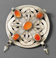 Turkestan | Button / collar pin ~ golchakah | Silver and carnelian | Yomud | 20th century
