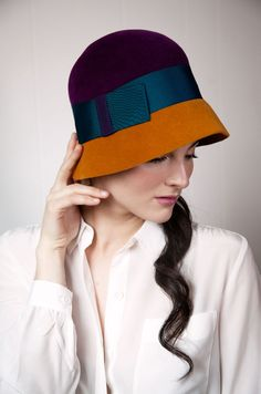 I adore this hat - especially the color combination!  via honey-kennedy-yestadt-millinery-fall-2012-08
