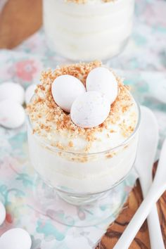 Skipping dessert is for the birds! Finish off an Easter dinner or brunch the right way with this simple and quick White Chocolate Mousse Nest recipe. This sweet, creamy dessert is topped with toasted coconut flakes and little chocolate eggs to give it a truly spring-inspired look.