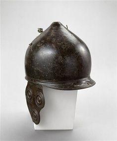 Montefortino type helmet with cheeckpieces of three discs. 3rd century BCE. Height: 23 cm, diam. 23 cm. Musée d' Archéologie Nationale Saint-Germain-en-Laye.