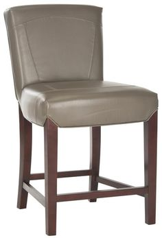 """Safavieh HUD8202B Ken Counter Stool Clay Choose the Ken Counter Stool for luxurious comfort at the kitchen counter or pub table. Upholstered in clay-toned bicast leather with stitched detailing on its straight back, this eclectic stool_s sturdy frame is beech wood in an elegant cherry mahogany finish. With 24-inch seat height, Ken offers cushioned comfort and stylish seating that complements traditional or transitional interiors. Dimensions: 20.7"""" x 24.2"""" x 37"""""""