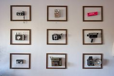 This is an awesome way to display a camera collection! I just wonder how they're on the wall....clear shelves?