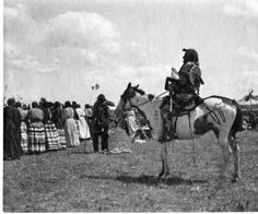 Native American man on painted horse next to crowd of people :: MS 035 North American Indian Photographs