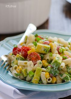 Summertime Pasta Salad with Greek Yogurt Dressing -- Brown rice pasta, corn, tomatoes, avocado and Greek yogurt dressing make this pasta salad healthy, creamy and delicious. You won't miss the mayo, trust me!