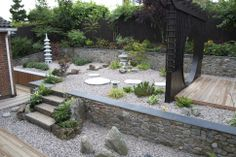 This is ONe of the AFTER pictures from Anna Barker's Japanese garden project. At www.thejapanesegardenclub.com you can access an interview, video and timelapse video of the project from start to finish including tips, what to do, what Anna did, how she did it and why she did what she did within the garden space as it came to life. Top qulaity information for Japanese garden lovers. www.thejapanesegardenclub.com