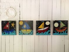 collection of boats,.each one made with layers of paint, and paper (see detail in close up)