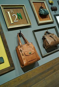 Fun idea for a craft fair booth - hang handmade products on the wall and highlight with a frame. Craft Show Displays, Shop Window Displays, Store Displays, Display Ideas, Market Displays, Fossil Watches, Fossil Purses, Fossil Bags, Diy Purse Organizer