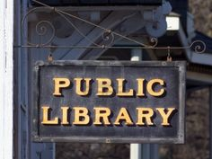 A Small town Public Library Sign invites the public Stock Photo - 14697718