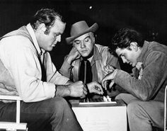 Bonanza..Hoss and Joe Cartwright playing chess ...Ben watching when are they gonna finish?