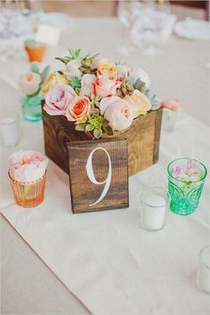 rose and succulent flower box centerpiece with wooden table number / http://www.deerpearlflowers.com/unique-wedding-centerpiece-ideas/6/