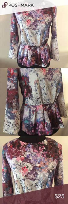H&M Peplum Blouse Floral with a bit of paint splatter. New condition no flaws. Full zip up back. H&M size 2 would say it's an XS-S.  Offers welcome through the offer button only. No trades, posh only! H&M Tops Blouses